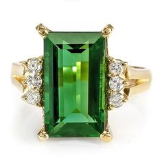 Emerald cut green tourmaline engagement ring.