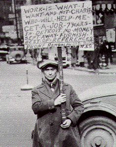 "This picture shows a man that is holding a sign that is written that the man does not want charity but a job. This is a great representation of how people felt and what they had to get through in the Great Depression.   People wanted work so they would not have to owe anyone anything. So they could have freedom. ""We wouldn't ask nobody if we could. Jus' say, 'We'll go to her,' an' we would. Jus' milk the cow and sling some grain to the chickens an' go to her."" (Steinbeck 61)."