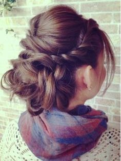 A French twist going into a low messy bun with a bouffant