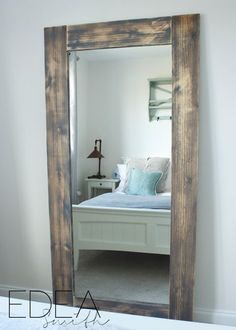 DIY - UPCYCLED 'IKEA HACK' MIRROR FRAME [with plans!] a great IKEA HACK to add a rustic frame. Upcycle Project. WITH PLANS. Read more at EDEA Smith www.edea-smith.co.uk