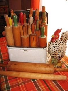 vintage rolling pin display   Display vintage rolling pins in antique bread box. Cute idea!