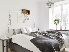 White and grey bed.