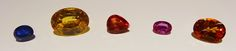 From left to right: 3.70 ct blue from Madagascar, 27.27 ct yellow from Sri Lanka (no heat), 5.67 ct Padparadscha from Malawi, 2.62 ct pink from Burma, and 10.09 ct from Sri Lanka. Natural History Museum of L.A. Minblog:  #Tucson Gem & Mineral Show