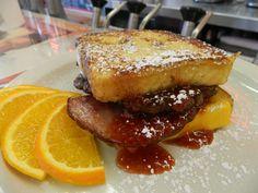 FULL MONTY-Half pound burger, American cheese, Swiss cheese, smoked ham, berry jam on French toast
