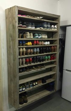 Giant Shoe Rack Made Out Of Discarded Pallets.