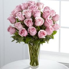 Picture-perfect soft pink roses make a beautiful gift for the lovely lady in your life. Wife, mother, daughter or sweetheart, she's sure to cherish this bouquet of pastel pink roses accented with seeded eucalyptus and arranged in a clear glass vase. New Baby Flowers, Mothers Day Flowers, Cheap Flowers, Send Flowers, Fresh Flowers, Rosen Arrangements, Floral Arrangements, Flower Arrangement, Amazing Flowers