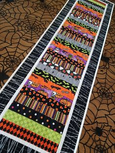 """Halloween table runner strip pieced table runner quilted Halloween table decor Halloween table quilt orange black """"extra long"""" 15 x 54 : Halloween table runner, modern patchwork table quilt, quilted strip pieced table topper, bl Patchwork Table Runner, Table Runner And Placemats, Table Runner Pattern, Quilted Table Runners, Halloween Runner, Halloween Table Runners, Halloween Table Decorations, Halloween Quilt Patterns, Christmas Tree Skirts Patterns"""