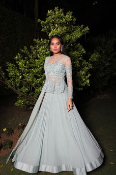 Peplum lehenga , sister of the bride lehenga , dove gret outfit , sparkly outfit , sheer peplum bouse, reception outfit , glamorous silhouette , dove grey