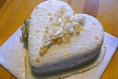 gold and white valentine cake with impressed fondant