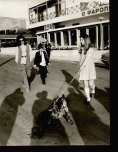 Jackie, John Jr., and Caroline walking their cocker spaniel, Shannon.   Shannon was brought home by JFK in 1963.  Looks @ 1972-73.