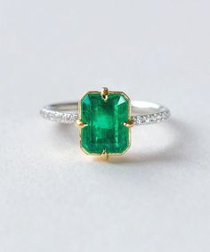 There are emeralds and there are Emerald Emeralds! This simply stunning post-consumer vintage emerald comes from the estate of a female gem collector and is absolutely magnificent! Set simply in 18k recycled yellow gold and Platinum this is the perfect right-hand ring or emerald engagement ring.