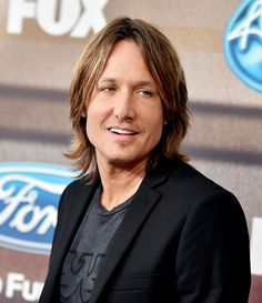 """Keith Urban Photos Photos - Musician Keith Urban arrives at Fox TV's """"American Idol XIV"""" finalist party at The District on March 11, 2015 in Los Angeles, California. - 'American Idol XIV' Finalist Party"""