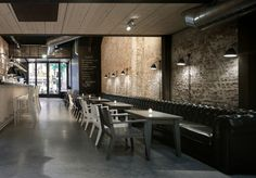 Classic Restaurant Interior Design in Amsterdam ... love the long leather bench seat and the exposed brick
