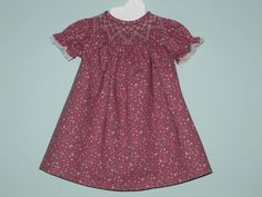 Hand smocked bishop dress for American Girl doll with matching bloomers.