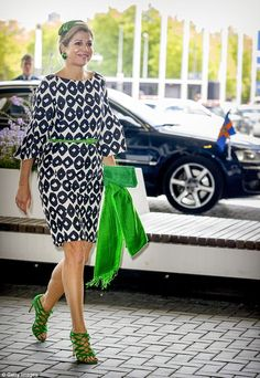 The Queen of the Netherlands stepped out in some rather quirky neon green accessories in Amsterdam on Tuesday.