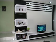 Modern tv unit design modern units and display shelves modern tv unit design ideas pdf Modern Tv Unit Designs, Living Room Tv Unit Designs, Modern Tv Wall Units, Tv Stand Designs, Modern Shelving, Modern Wall, Built In Tv Wall Unit, Wall Units With Fireplace, Tv Unit Furniture Design