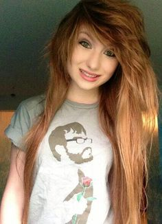 Tiffany Kudrikow, Xxfluffypunkxx on YouTube. Not my favorite, but I love her hair and how opinionated she is!