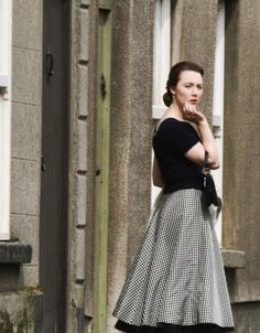 Saoirse Ronan as Eilis Lacey in the film Brooklyn (2015). Her wardrobe was mostly authentic vintage from 1950s and the costume design was by Odile Dicks-Mireaux.