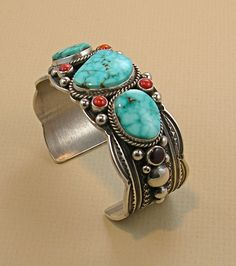 Cuff | Guy Haskie (Navajo).  Sterling silver, Kingman turquoise, red coral, sugilite
