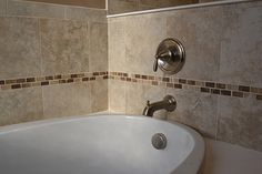 Amazing tub tile pattern. Large tile with small tile accents. Tons of great bathroom ideas here: