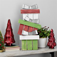 Not every present has to go under the tree! Add new metal accents to your mantel for a modern, yet rustic Christmas look.