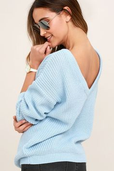 When your adventures include a light breeze, make sure the Island Ferry Light Blue Sweater comes along for the ride! Medium-weight knit begins at a rounded neckline, then travels to a trendy, low V-back. Wide-cut bodice and loose long sleeves taper slightly to ribbed knit hems.