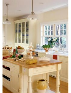 Better Homes and Gardens - Home and Garden Design Ideas Large windows at sink, counter goes right up to window (I would omit the small bump-up and have it level right to the window, and maybe build out the windows a bit so the counter was a little deeper)