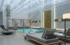 Luxurious indoor pool design for the Olaya hotel by Comelite Architecture Structure and Interior Design, the interior space is mainly lit up using the skylight ceiling along with the soft indirect lighting. Light gray wall tiles and flooring with golden highlights creating a simple yet elegant recreational space.