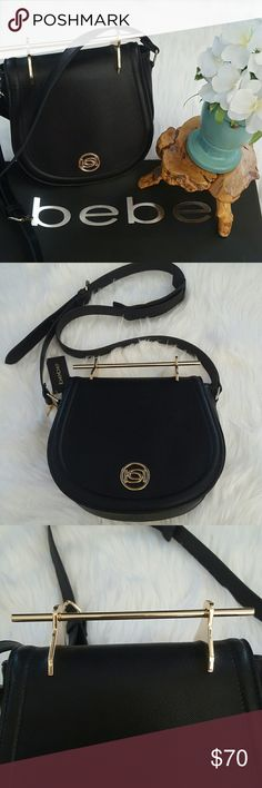 """BEBE CROSSBODY / SADDLE BAG It is about classicism and elegance!! UNIQUE hardware top handle  Tonal topstitching edges structured body. Adjustable crossbody strap Organized 2-compartment design with card slots and a zip pocket inside.  Front goldtone bebe logo. 10""""H x 8""""W x 3 1/2 SHELL:100% polyurethane  INNER LINING:100% Polyester bebe Bags Crossbody Bags"""