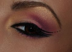 pink, golds, black, and glitter  start with gold, put pink in the corners of eyes, and liquid eyeliner