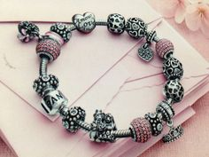 Pink pandora bracelet and charms