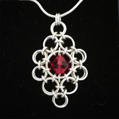 Bold chainmaille pendant with Swarovski Crystal. #contemporaryjewellery #handcrafted #chainmaille #jewellery #pendants #Swarovski #statementjewellery #ScottishDesign #helensburgh