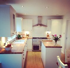 Our new kitchen - white, wooden shaker units, oak work tops, fixed island, white… Open Plan Kitchen, Kitchen Layout, New Kitchen, Kitchen Dining, Kitchen Decor, Kitchen White, Kitchen Ideas, Kitchen Sinks, Kitchen Island