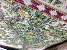 Peacock cross stitch - more back stitching