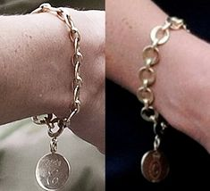 The gold bracelet was a wedding gift from Kate's step-mother-in-law, The Duchess of Cornwall. The disc charm has Kate's monogram on one side, and Camilla's on the other. Both Cs are under a coronet, but Kate's C has an extra curl, while Camilla's is surrounded by a circle. We haven't seen it in a while but the Duchess wore it quite frequently following the royal wedding at events such as Armed Forces Day and Wimbledon.