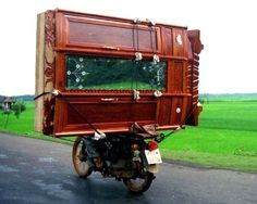 More here:  http://news.motorbiker.org/blogs.nsf/dx/25-motorcycles-carrying-anything-even-the-sink---part-2.htm