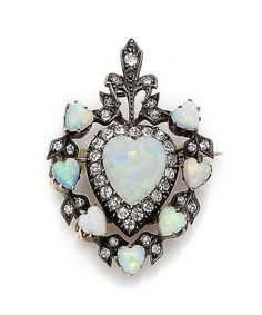 An opal and diamond heart brooch/pendant, circa 1890. The openwork cartouche of foliate design, centrally-set with a heart-shaped cabochon opal within an old brilliant-cut diamond border, to a further surround of similarly-shaped cabochon opals and similarly-cut diamonds, mounted in silver and gold, diamonds approx. 0.90ct total, length 4.5cm, fitted case by John Byrne & Son Ltd