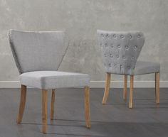 With its chic retro design the Isabella Grey Fabric Dining Chair brings a uniquely memorable touch to any dining area living room or anywhere else in High Quality Furniture, Unique Furniture, Furniture Design, Gray Dining Chairs, Fabric Dining Chairs, Dining Area, Upholstery Fabric For Chairs, Chair Fabric, Solid Oak Table