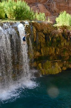 Cliff jumping off waterfall - Rock Falls  - Grand Canyon