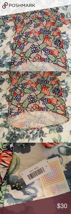 NWT xxs Lula roe Americana irma!!!! This is so cute!!! It's brand new!!! With tags and everything paid $45 for it i have another one I'm going to wear instead just selling because I do not need it. It had the statue of liberty ad cute flag bow ties, and the shirt is gray with tiny gray stars!! It has mid length sleeves if you wear xxs,xs,s or maybe even medium it will fit. Very cute with a pair of skinny jeans or leggings. LuLaRoe Tops Tees - Short Sleeve