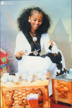 lady serving ethiopian coffe (buna) and spinning cotton