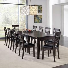 Classic and Traditional Dining Set that can seat up to 12. I would buy this 11 piece set, and seat 5 on each side of the table. Then purchase two upholstered chairs for the head of the table to complete seating for 12.