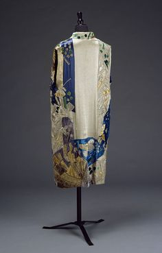 Evening coat (rear view) Place of origin: Paris, France (made) Date: ca. 1925 (made) Artist/Maker: Natalia Goncharova, born 1881 - died 1962 (designer) Marie Cuttoli, born 1879 - died 1973 (probably, designed for) House of Myrbor (retailer) Materials and Techniques: Hand-sewn and hand-embroidered silk and satin, appliqué, lined with satin Museum number: T.157-1967, V&A