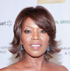 Great Hair Style for 50+..With its side-swept bangs and upturned ends, this over 50 hairstyle is both youthful and chic on Alfre Woodard.