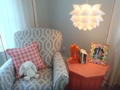 Love the gray and coral color combo in this #nursery!