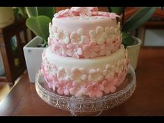 How to make a fondant cake step by step - YouTube  Easy fondant cake with a lot of flowers in different pink colors. Amazing results for  the amount of work (fairly easy and few tools)