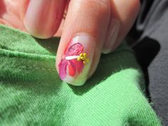 Try this easy at-home tropical hibiscus flower nail art for your manicure or pedicure.