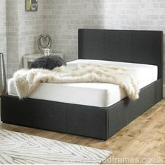 Versatile storage ottoman bed frame upholstered in a charcoal fabric. Small Double x Double x King Size x or Super King x Manufactured by Emporia. Super King Size Bed, King Size Bed Frame, Leather Headboard, Wood Headboard, Upholstered Bed Frame, Upholstered Ottoman, Ottoman Bed, Fabric Ottoman, Bed Frame With Storage