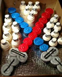 Star Wars Lightsaber and Stormtrooper cupcakes. I drew the faces on large marshmallows with a food grade marker