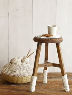 I love this idea on the stool legs....brilliant ! My Mama made me a knitting basket like this one 35 yrs ago !  White Knitted Home Decorations - White Home Decor - Country Living